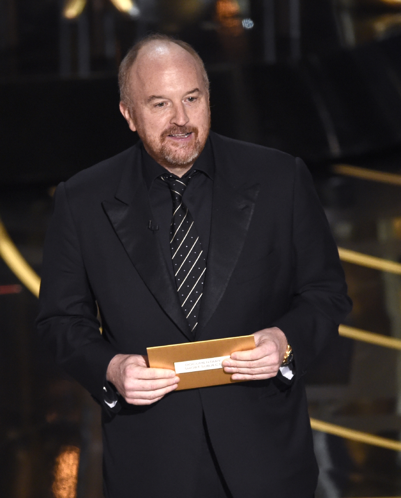 Louis C.K. presents the award for best documentary short film at the Oscars on Sunday, Feb. 28, 2016, at the Dolby Theatre in Los Angeles. (Photo by Chris Pizzello/Invision/AP)