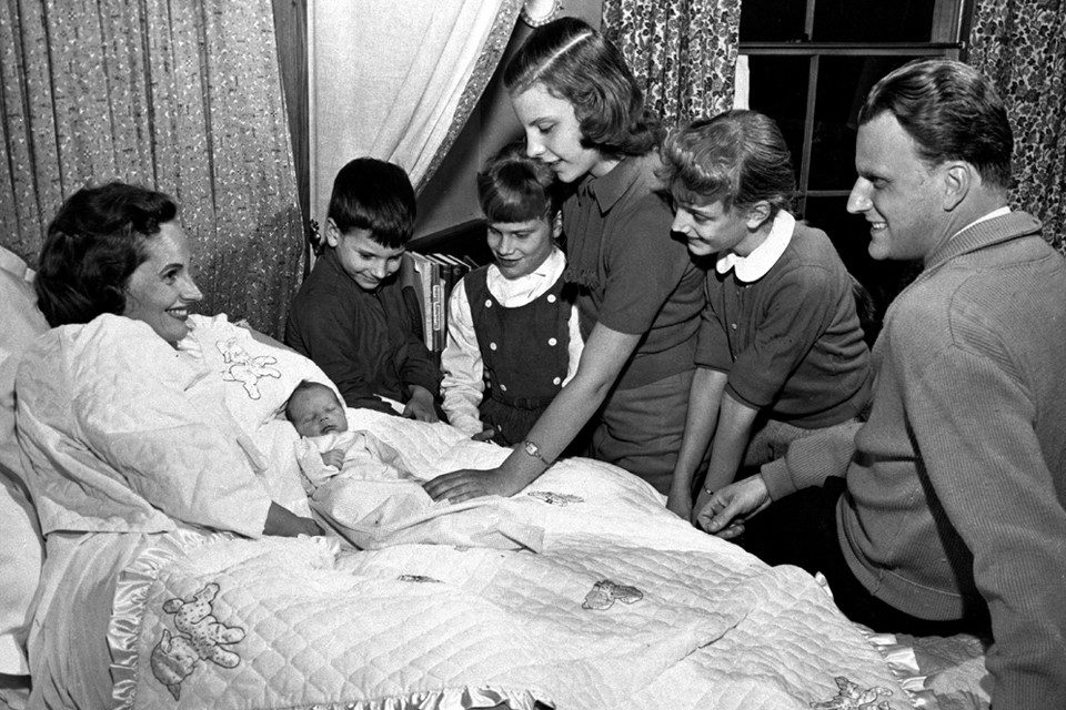 The fifth of the Grahams' children, Ned, at only four days old. From left to right: Franklin, 5; Ruth (Bunny), 7; Gigi, 12; and Anne, 9. (Photo: Billy Graham Evangelistic Association)