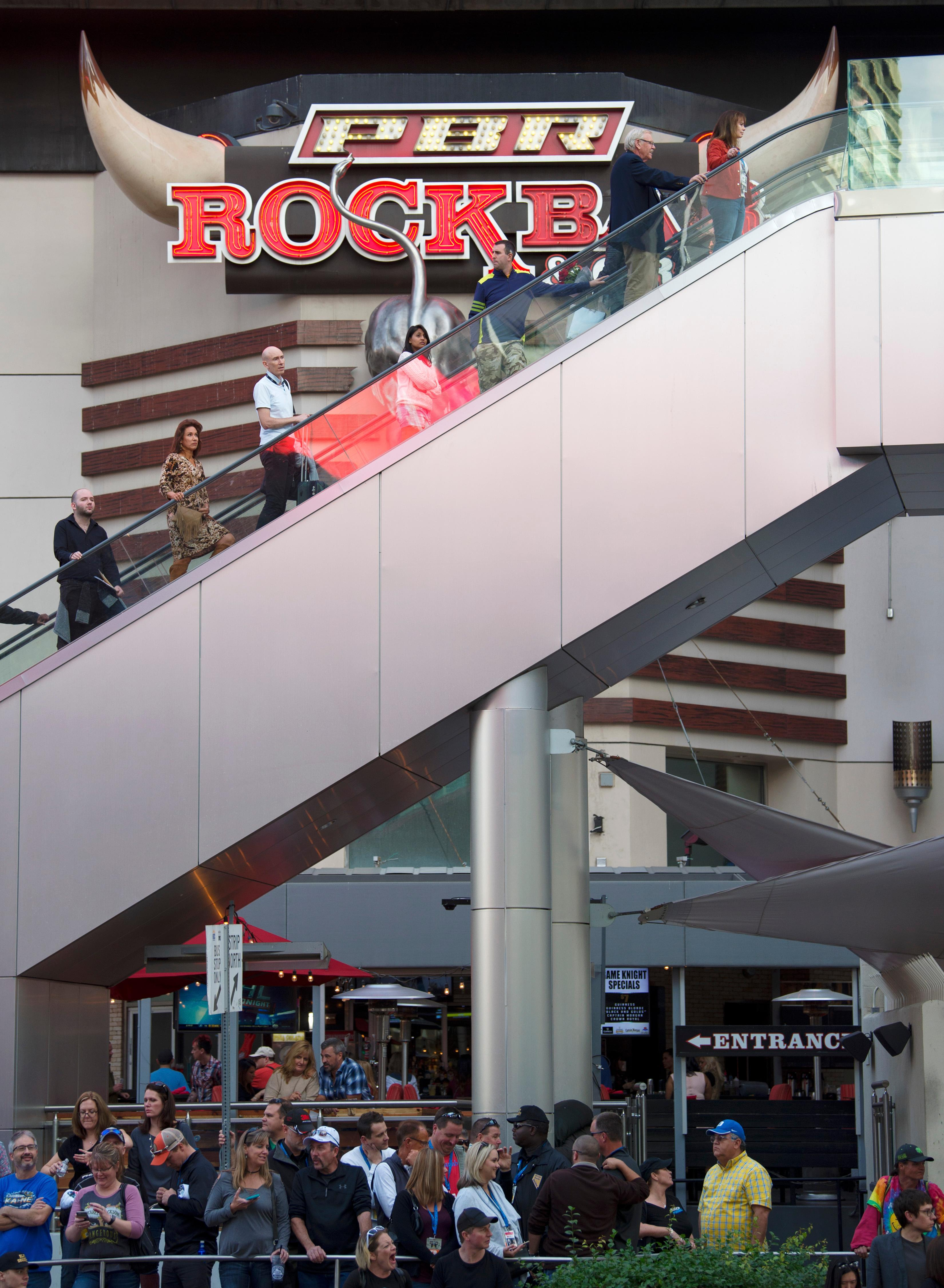 People ride an escalator up to a pedestrian walkway during the NASCAR Victory Lap on the Las Vegas Strip being held as part of Champions Week Wednesday, November 29, 2017. CREDIT: Sam Morris/Las Vegas News Bureau