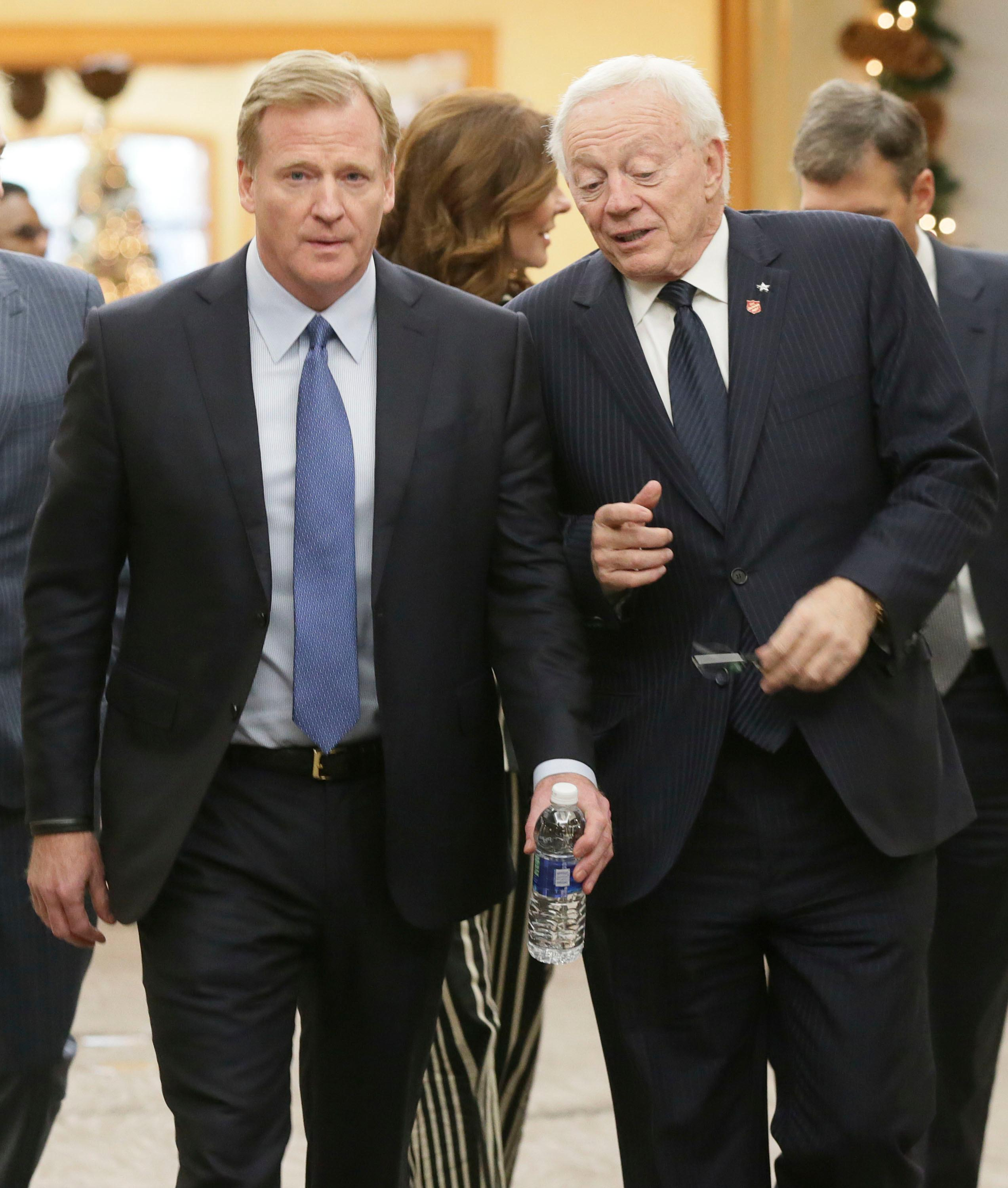 NLF Commissioner Roger Goodell, left, walks with Dallas Cowboys owner Jerry Jones during the NFL owners winter meeting in Irving, Texas, Wednesday, Dec. 13, 2017. (AP Photo/LM Otero)