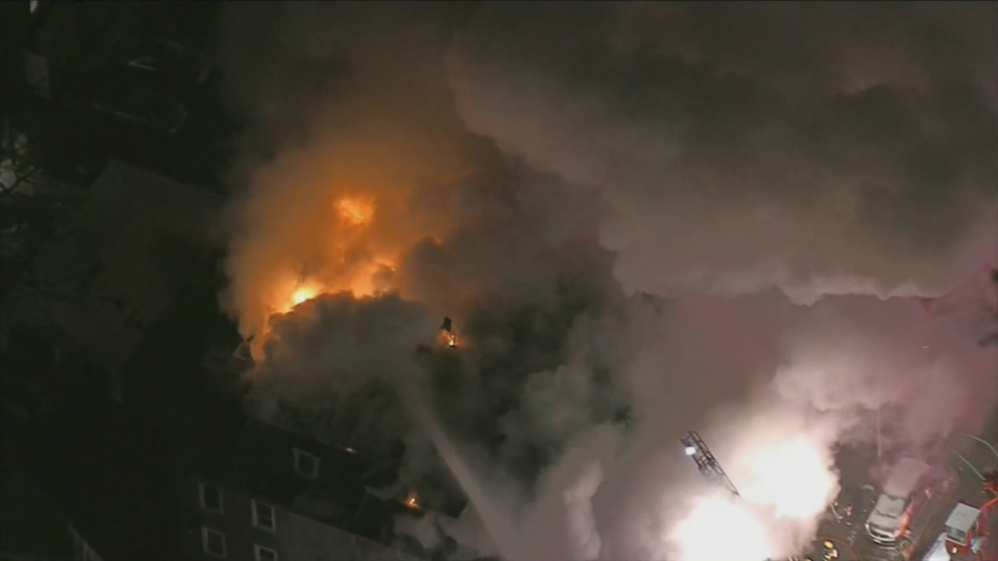 Heavy smoke poured from a building on West Street in Worcester, early Friday, Feb. 9, 2018. (NECN)