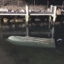 Man clings to overturned boat for 12 hours
