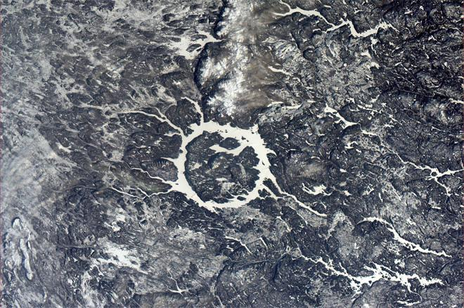 A wider view of the Manicouagan impact crater. (Photo & Caption: Rick Mastracchio, NASA)