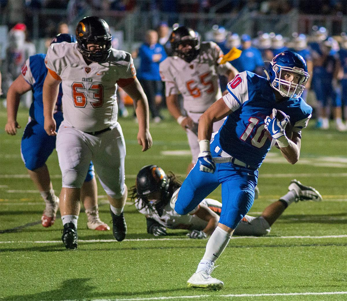 Churchill Lancers Tyson Bennion (#10) carries the ball past Crater Comets defense. Churchill defeated Crater 63-21 on Friday at their homecoming game. Churchill remains undefeated with a conference record of 9-0. Photo by Rhianna Gelhart, Oregon News Lab