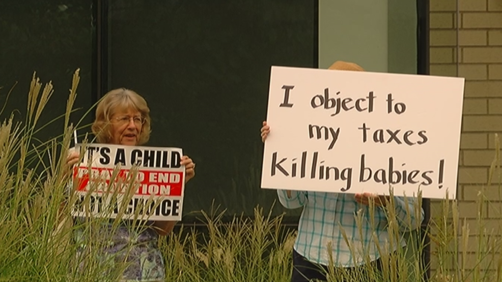 Right to Life protesters gather while Governor Brown visits