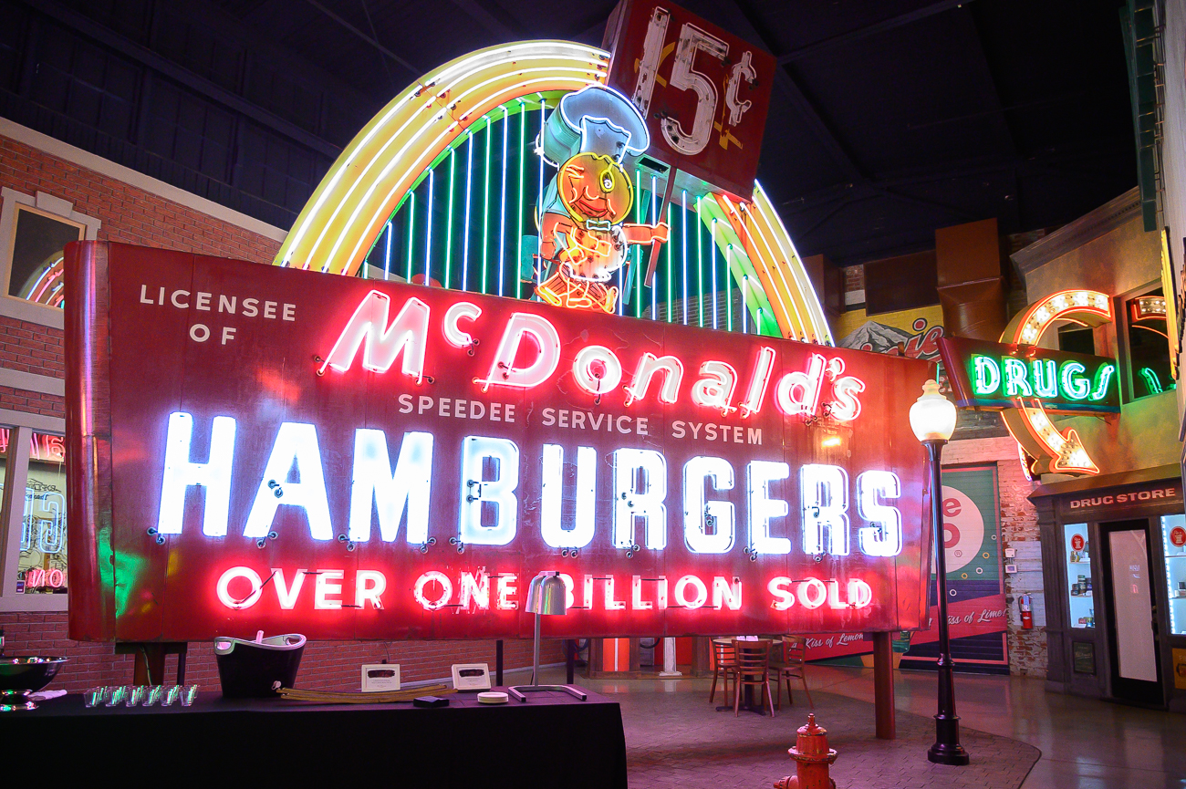 "When the history tour resumed, Alex talked about the giant McDonald's sign in the room. The sign was in Huntsville, AL in the 1960s. It features a 15¢ price at the top along with the phrase ""over one billion sold"" at the bottom. In the 1980s, the price of burgers had increased along with how many burgers had been sold. The museum restored one side to the 1960s version and kept the 1980s version on the other side, which now has a piece of sheet metal over the 15¢ price and changed the language at the bottom to ""over 99 billion sold."" / Image: Phil Armstrong, Cincinnati Refined // Published: 1.24.20"