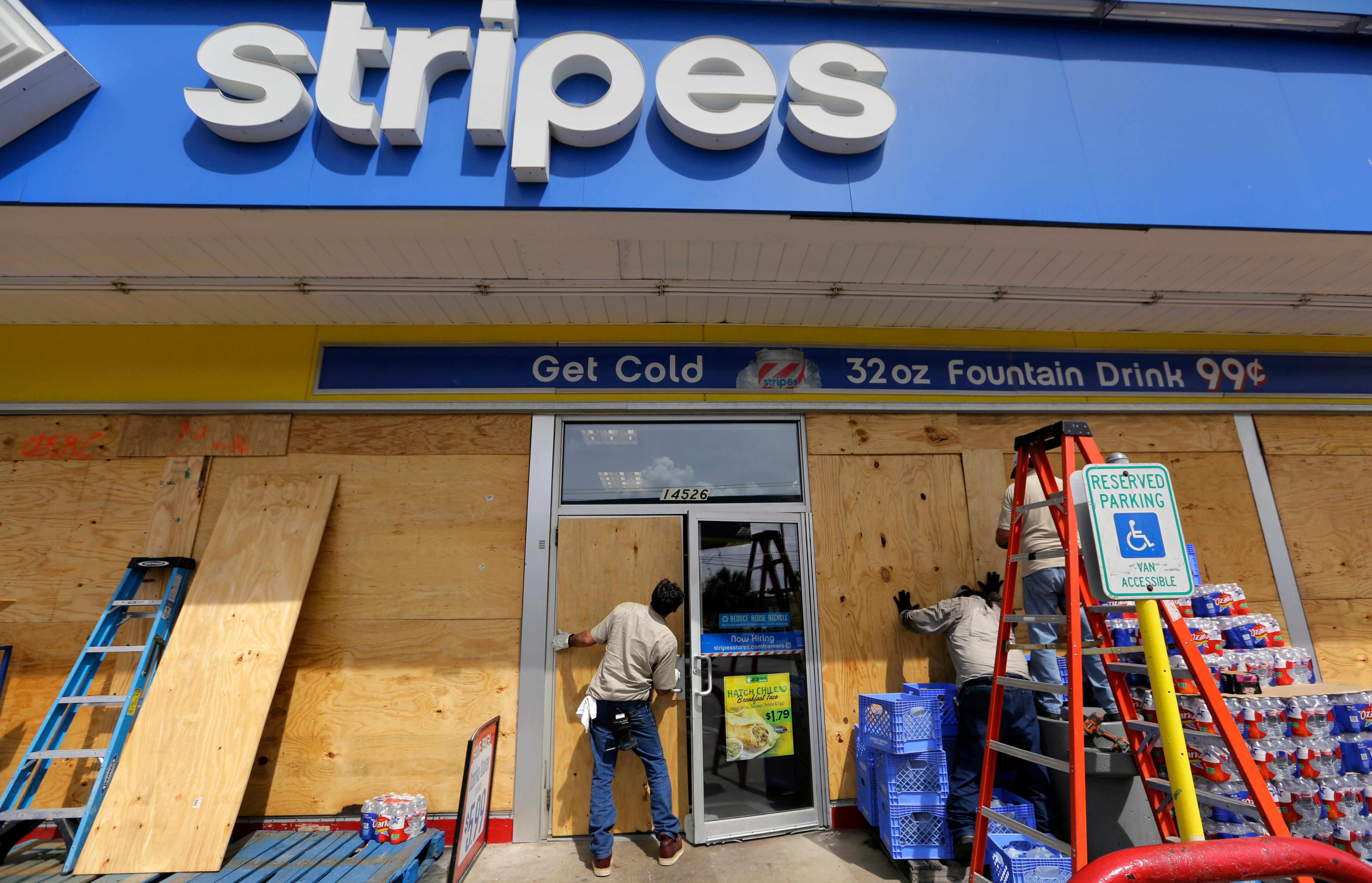 Stripes store workers board up windows in preparation for Hurricane Harvey, Thursday, Aug. 24, 2017, in Corpus Christi, Texas. Two counties have ordered mandatory evacuations as Hurricane Harvey gathers strength as it drifts toward the Texas Gulf Coast.   (AP Photo/Eric Gay)