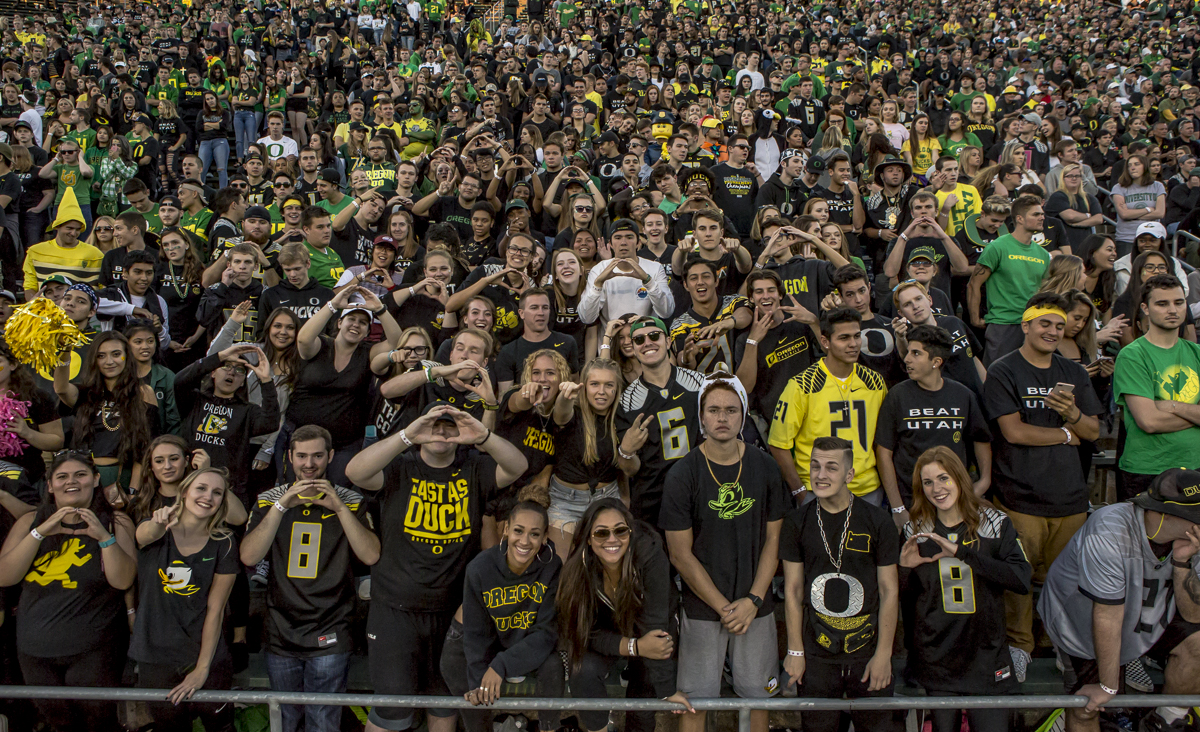 The Oregon student section cheers on the ducks during Oregon's homecoming game at Autzen Stadium. The Oregon Ducks defeated the Utah Utes 41 to 20 on Saturday, October 28, 2017. Photo by Ben Lonergan, Oregon News Lab