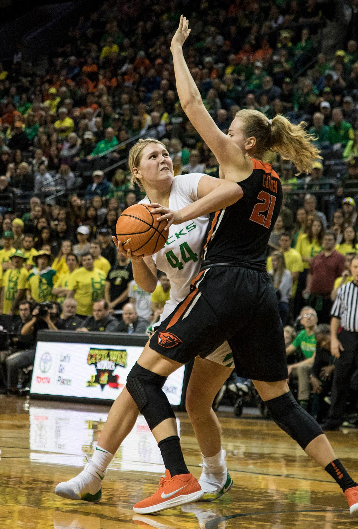 Oregon Ducks Mallory McGwire (#44) makes her way to the basket. The Oregon Ducks defeated the Oregon State Beavers 75-63 on Sunday afternoon in front of a crowd of 7,249 at Matthew Knight Arena. The Ducks and Beavers split the two game Civil War with the Beavers defeating the Ducks on Friday night in Corvallis. The Ducks had four players in double digits: Satou Sabally with 21 points, Maite Cazorla with 16, Sabrina Ionescu with 15, and Mallory McGwire with 14. The Ducks shot 48.4% from the floor compared to the Beavers 37.3%. The Ducks are now 7-1 in conference play. Photo by Rhianna Gelhart, Oregon News Lab