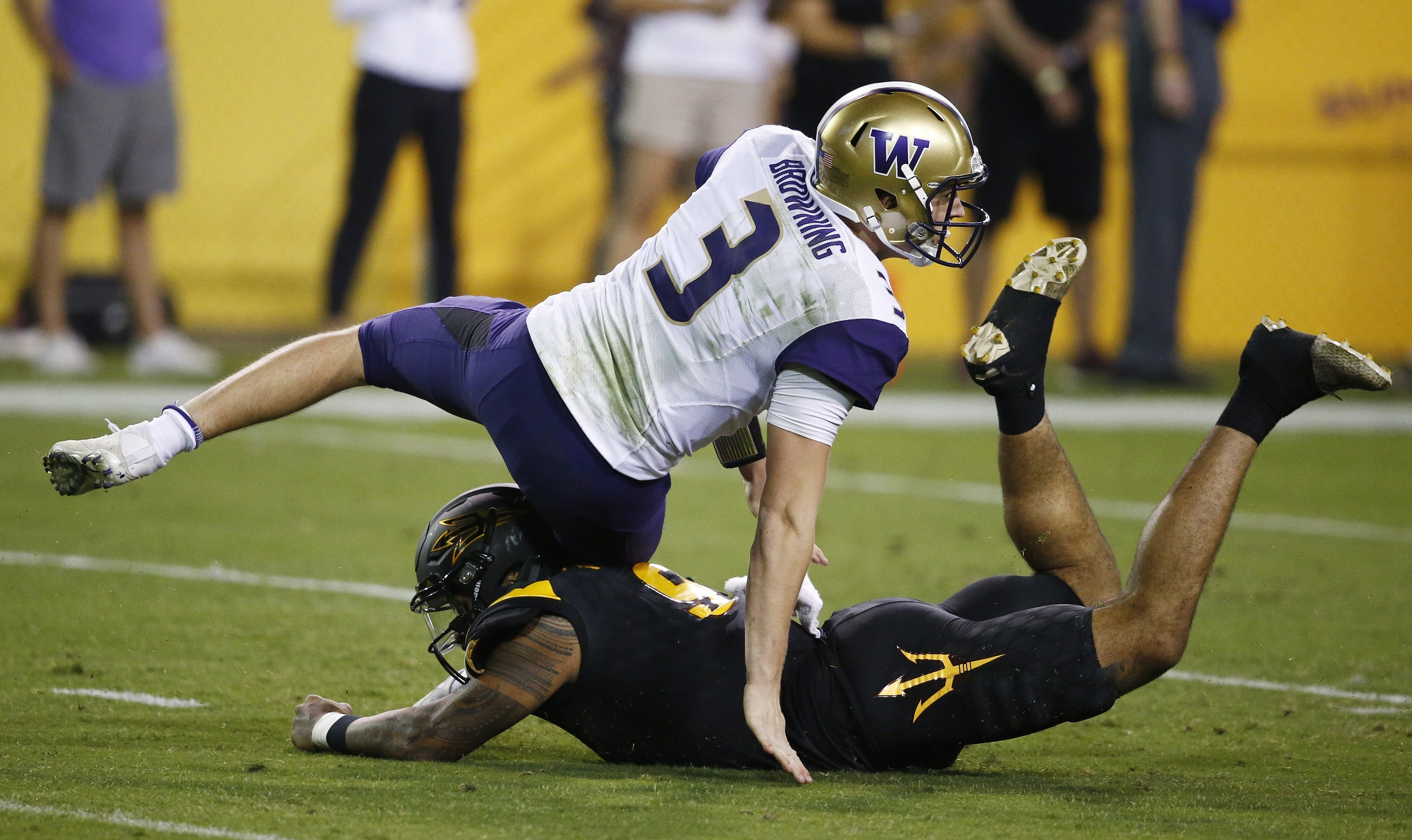 Washington quarterback Jake Browning (3) gets taken down by Arizona State's Jay Jay Wilson (9) during the first half of an NCAA college football game, Saturday, Oct. 14, 2017, in Tempe, Ariz. (AP Photo/Ross D. Franklin)
