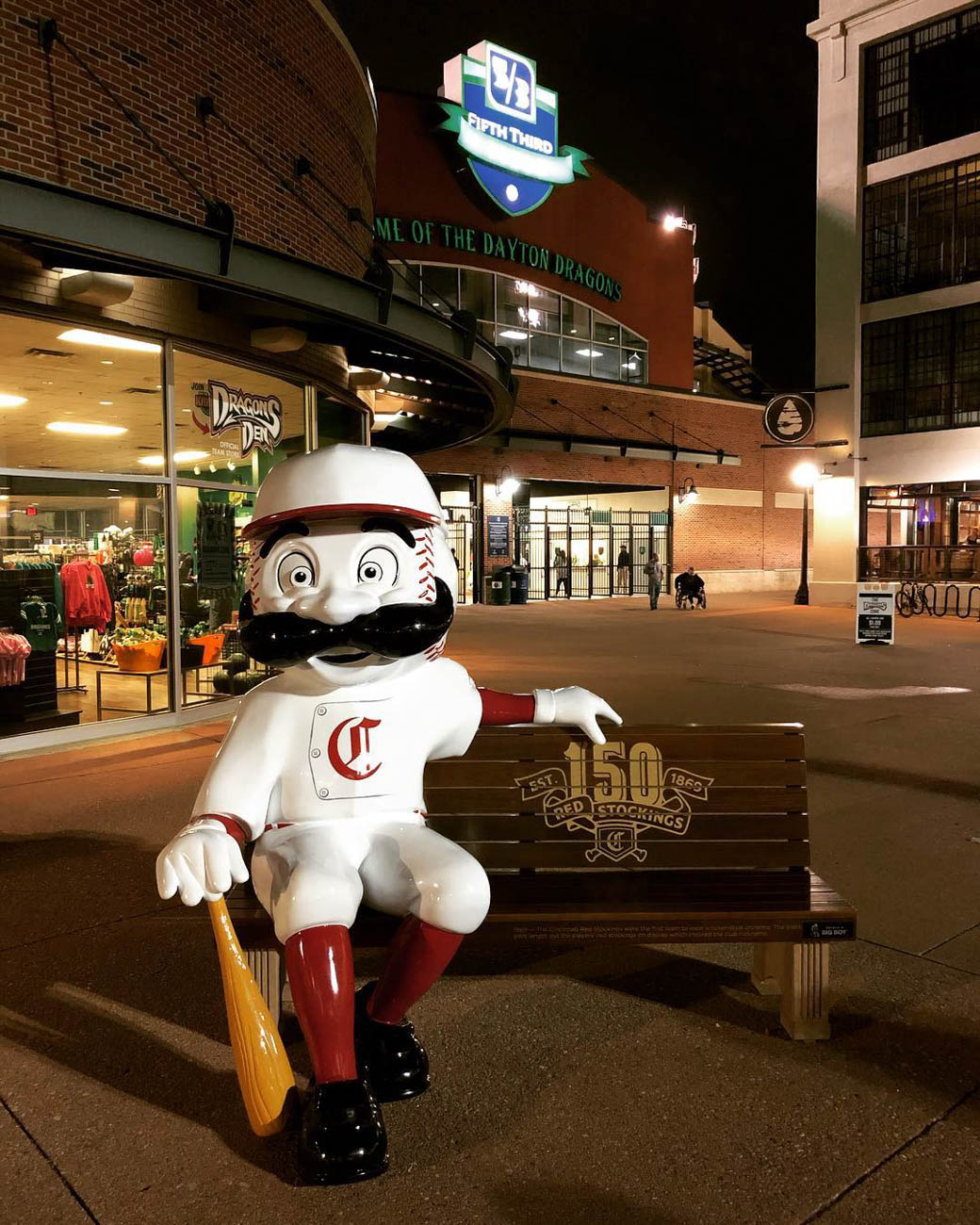To celebrate the Reds' 150th Anniversary, 24 benches featuring Mr. Redlegs sculptures have been added to various spots around the area, as well as out of town locations including Dayton, Loveland, and Louisville, for the perfect Reds photo op. The mascot sports different uniforms from throughout the team's history at each of the benches. The Reds have been wearing these same throwback uniforms during their 2019 season. / Location: Dayton Dragons / Uniform: 1869 / Image courtesy of Instagram user @phoenician_fan   // Published: 5.14.19