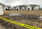 Authorities investigate a fatal explosion at an apartment building in Beaver Dam March 5, 2018.