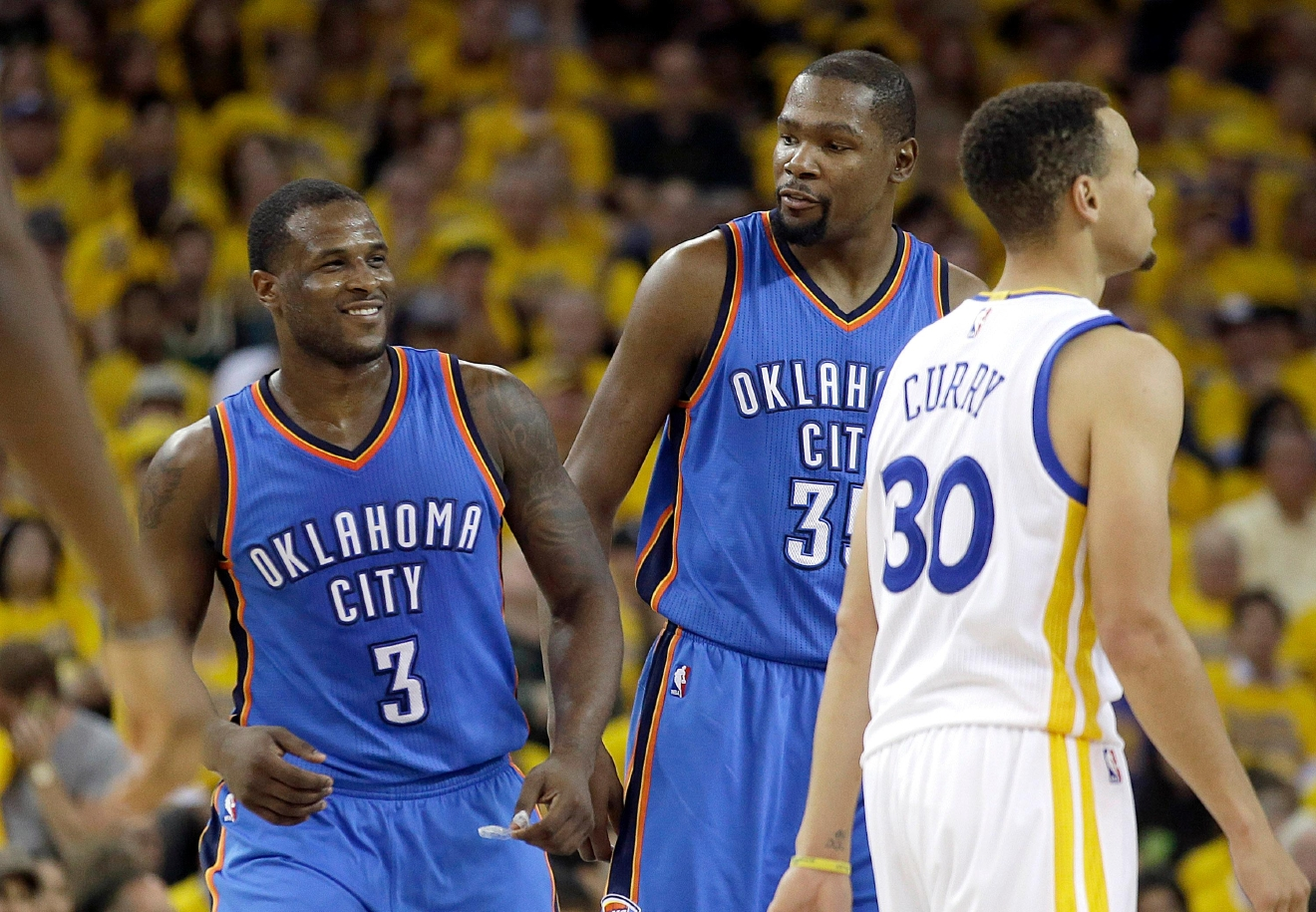Oklahoma City Thunder guard Dion Waiters (3) smiles next to forward Kevin Durant (35) and Golden State Warriors guard Stephen Curry (30) during the first half of Game 2 of the NBA basketball Western Conference finals in Oakland, Calif., Wednesday, May 18, 2016. (AP Photo/Marcio Jose Sanchez)