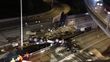 Semi-truck plunges off I-405 overpass onto freeway below, killing driver