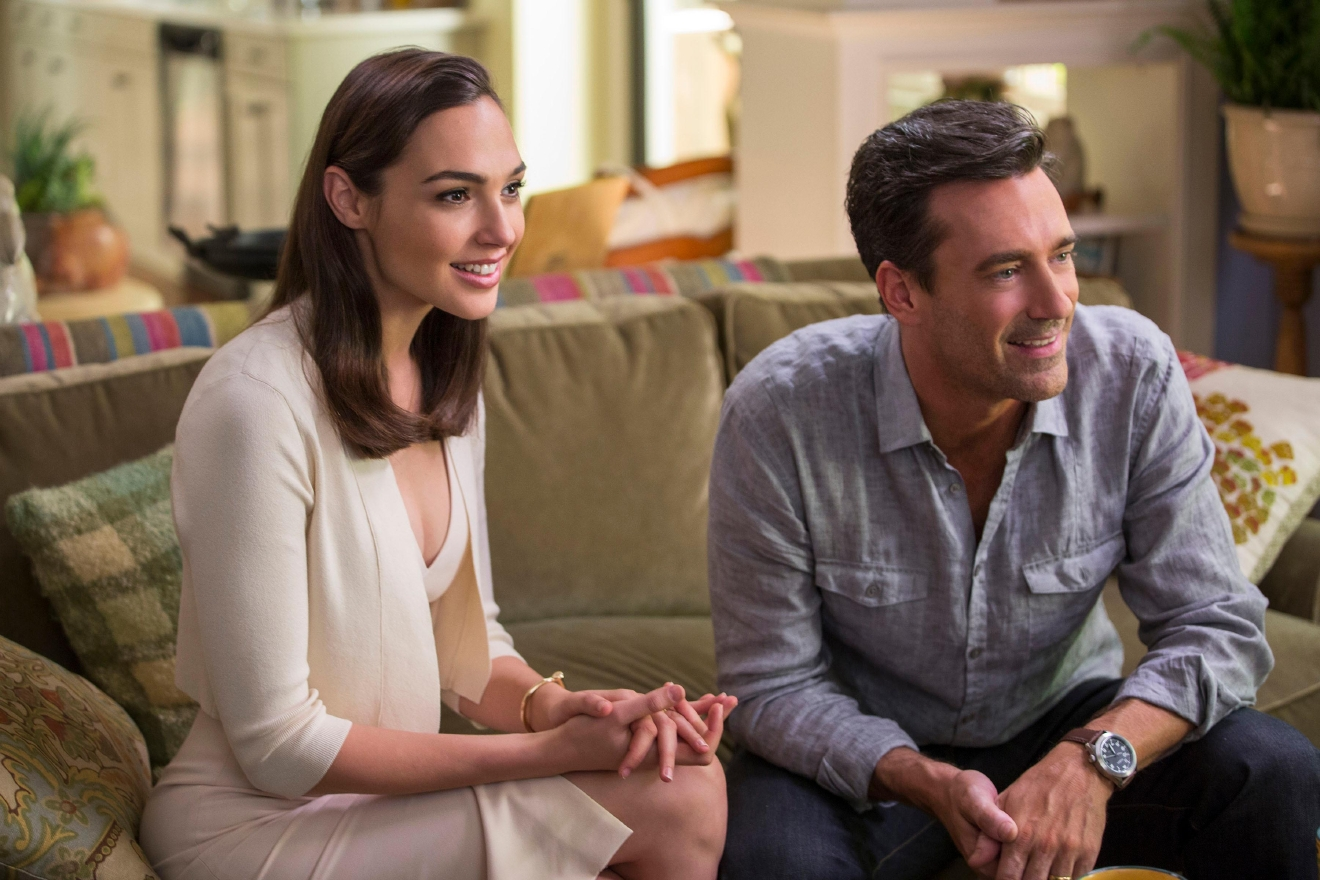"The impossibly gorgeous and ultra-sophisticated newly arrived suburban couple, Mr. and Mrs. ""Jones"" (Gal Gadot, Jon Hamm), are actually covert operatives. (Photo: Frank Masi, SMPSP)"