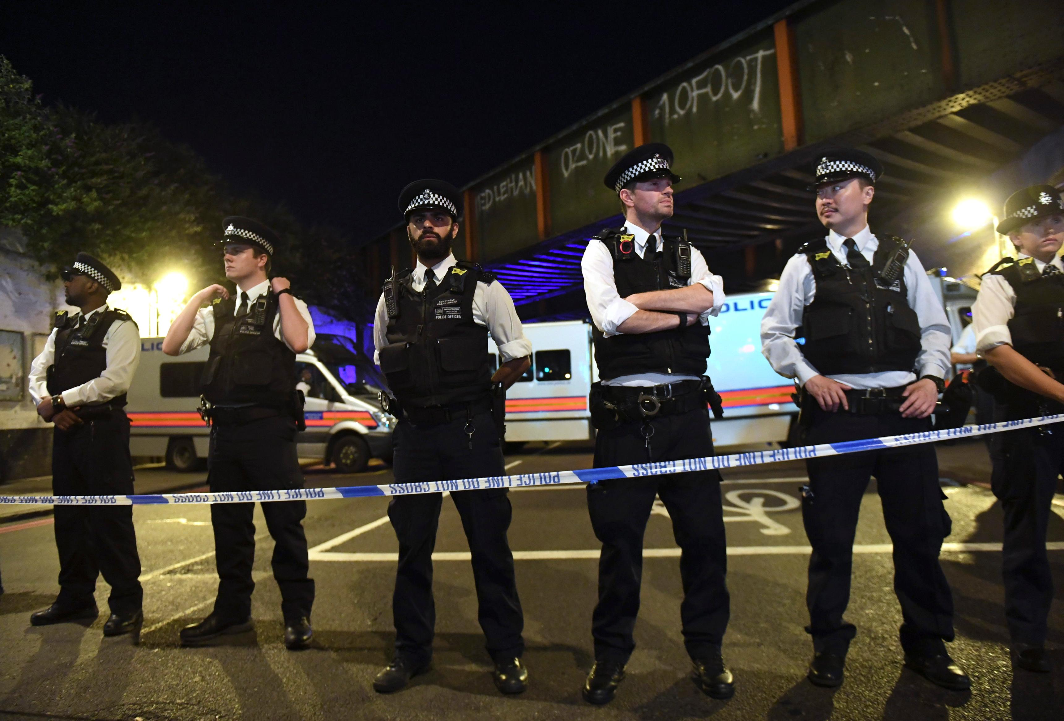 Police officers man a cordon near the Seven Sisters Road at Finsbury Park where a vehicle struck pedestrians in London Monday, June 19, 2017. Police say a vehicle struck pedestrians on a road in north London, leaving several casualties and one person has been arrested. (Yui Mok/PA via AP)