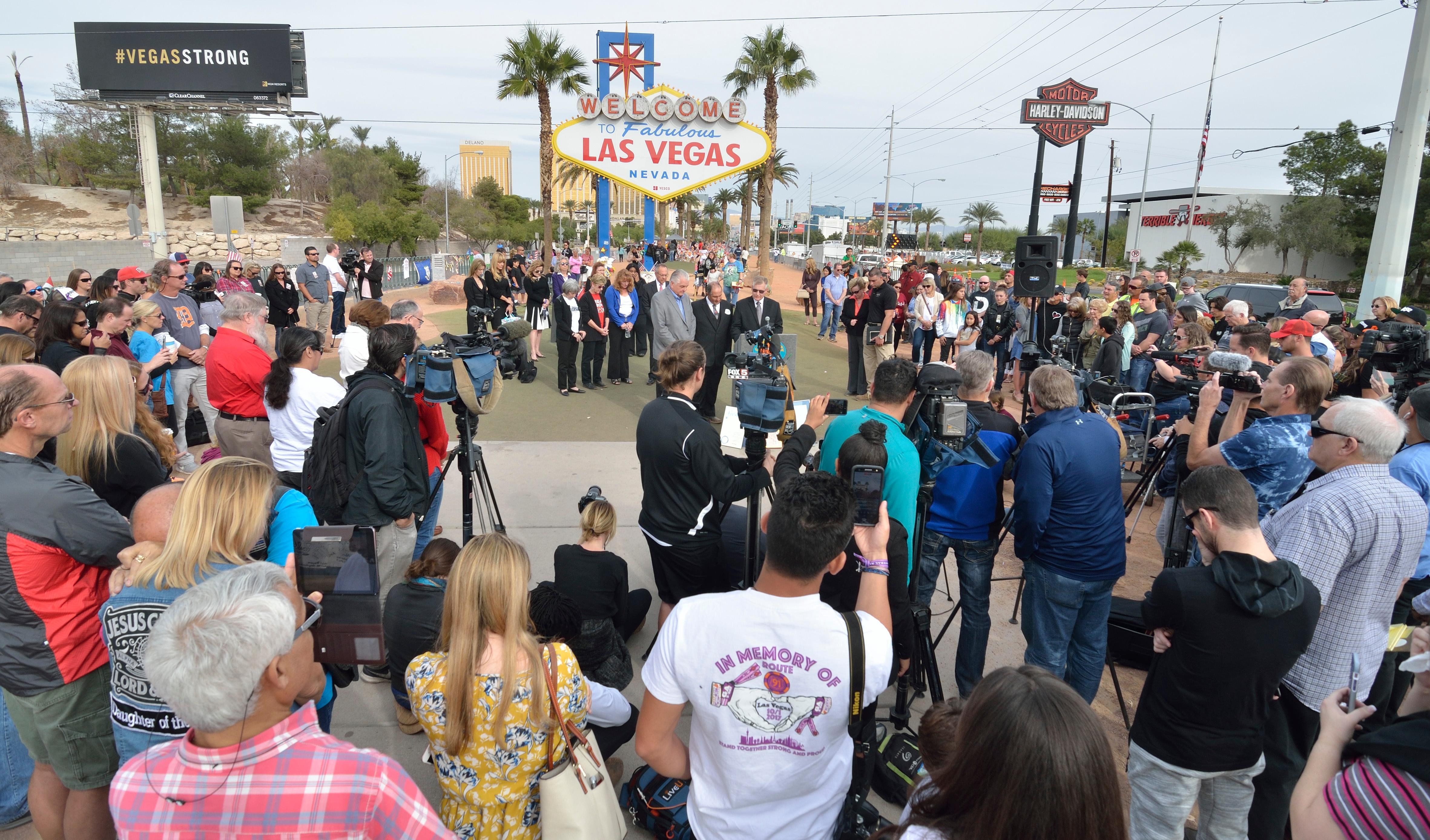 "The crowd is shown during ""Greg Zanis Day"" at the Welcome to Fabulous Las Vegas sign on the Las Vegas Strip on Sunday, Nov. 12, 2017. Zanis, a carpenter from Aurora, Ill., was recognized by the Clark County commissioners for creating 58 crosses memorializing those who died during the Route 91 Harvest festival on Oct. 1. The crosses were scheduled to be moved to the Clark County Museum for its permanent collection. [Bill Hughes/Las Vegas News Bureau]"
