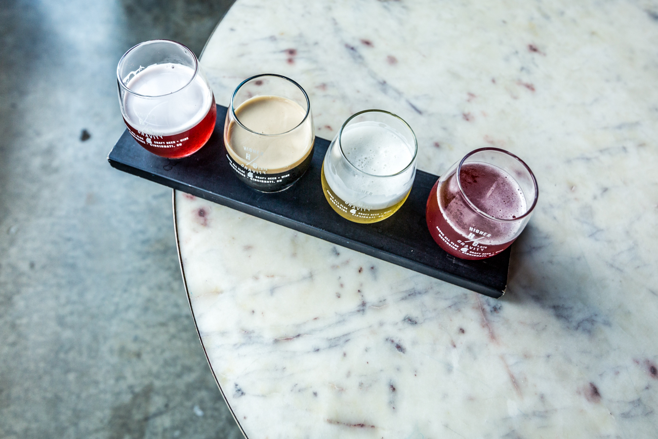 A flight featuring Rhinegeist's fruited sour Honoblublu, 50 West's coffee stout Coffee Please, Jackie O's smooth sipper Ricky, and Untitled Art's Brut Rose / Image: Catherine Viox{ }// Published: 9.16.19