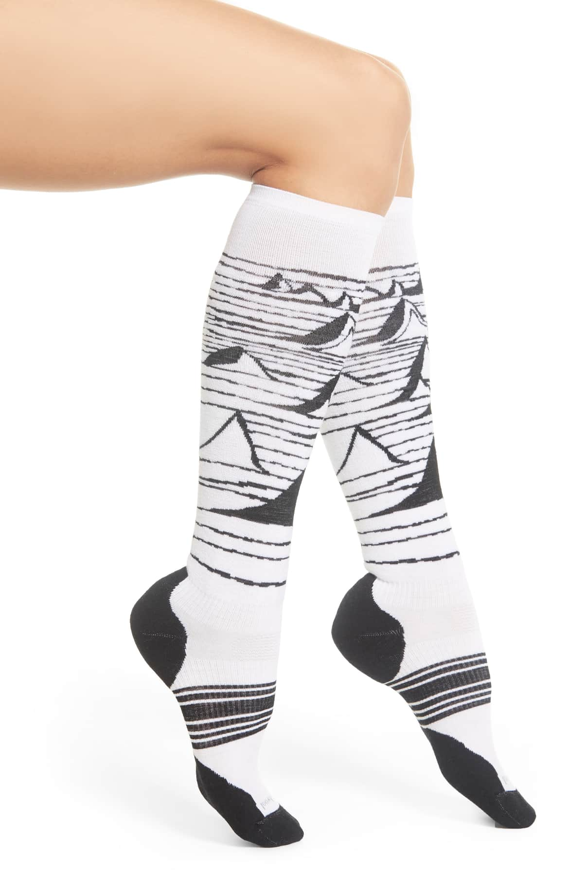 Keep your toes warm in these merino socks featuring light targeted cushioning, body-mapped mesh zones, a 4 Degree elite fit system and some bright mountain vistas.{ } $24.95 (Image: Nordstrom){ }