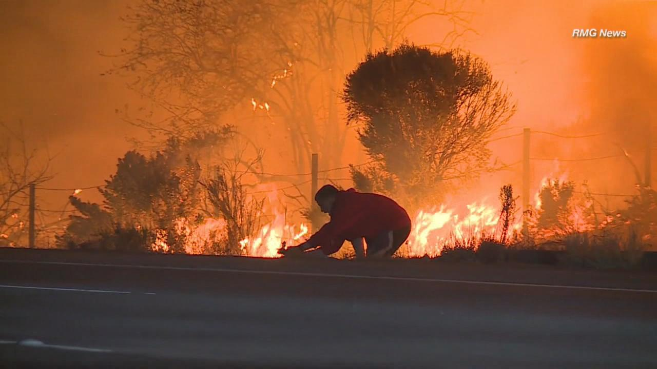 Footage captured a man who pulled over to save a wild rabbit from the flames on Highway 1 in Ojai, Calif. (RMG News via CNN Newsource)