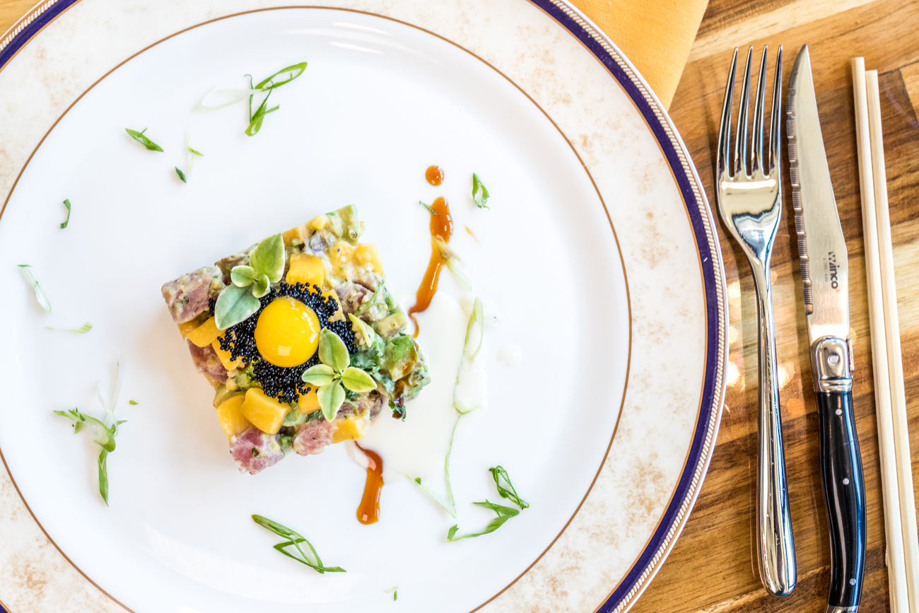 Sashimi Tartare: sashimi tuna, yellow tail, salmon, mango, avocado, and cilantro topped with quail egg / Image: Catherine Viox // Published: 8.19.20