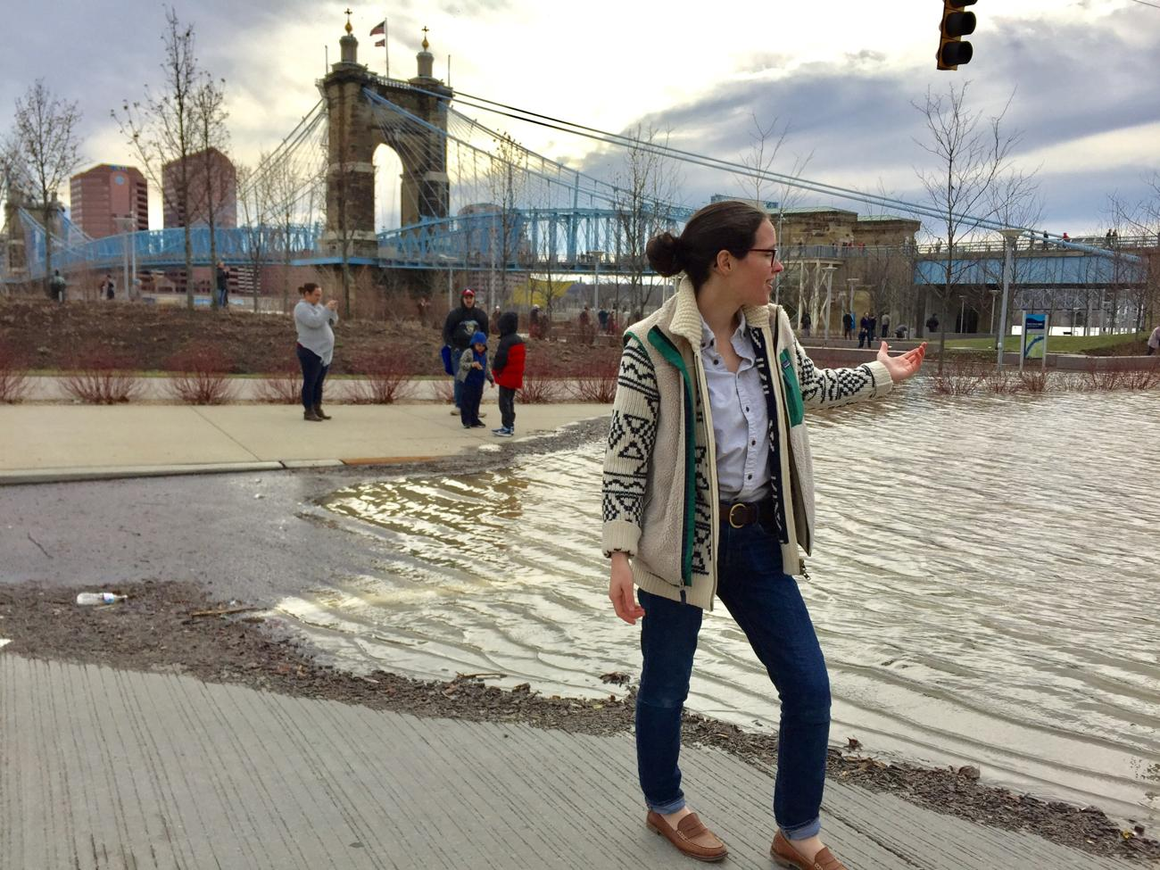 "Meg Ganulin ""reporting"" on damage from the flood at Smale Park / Image: Leah Zipperstein, Cincinnati Refined // Published: 2.26.18"