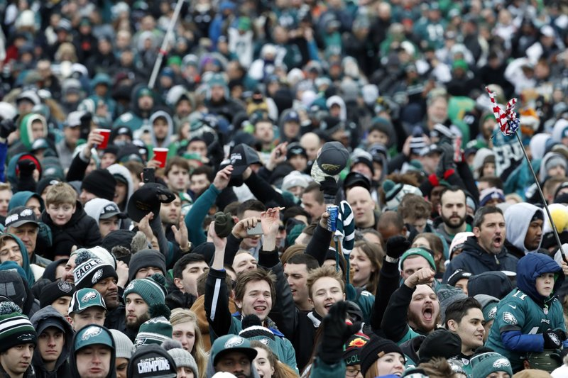 <p>Fans cheer as they watch a replay of Super Bowl 52 in front of the the Philadelphia Museum of Art before a Super Bowl victory parade for the Philadelphia Eagles NFL football team, Thursday, Feb. 8, 2018, in Philadelphia. The Eagles beat the New England Patriots 41-33 in Super Bowl 52. (AP Photo/Alex Brandon)</p>