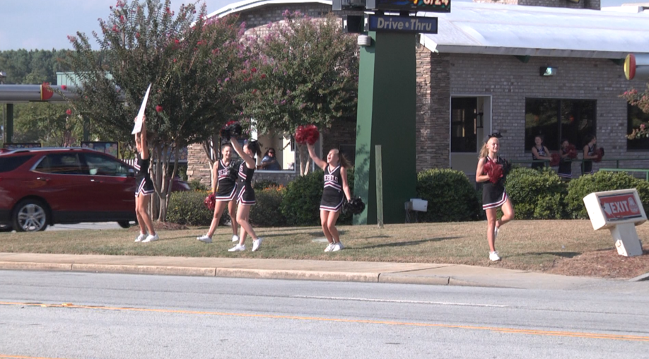 NEIGHBORLY NATALIE NEWBERRY CHEERLEADERS PICTURE.png
