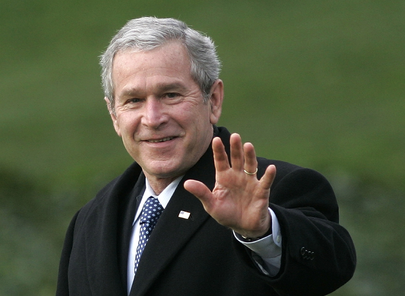 FILE-- In a Jan. 25, 2007 file photo President George W. Bush waves as he departs the White House in Washington for a trip to Missouri to speak on healthcare.  The eight-year Bush presidency has merited no more than a fleeting reference in the current GOP contest for the presidential nomination,   (AP Photo/Ron Edmonds/file)