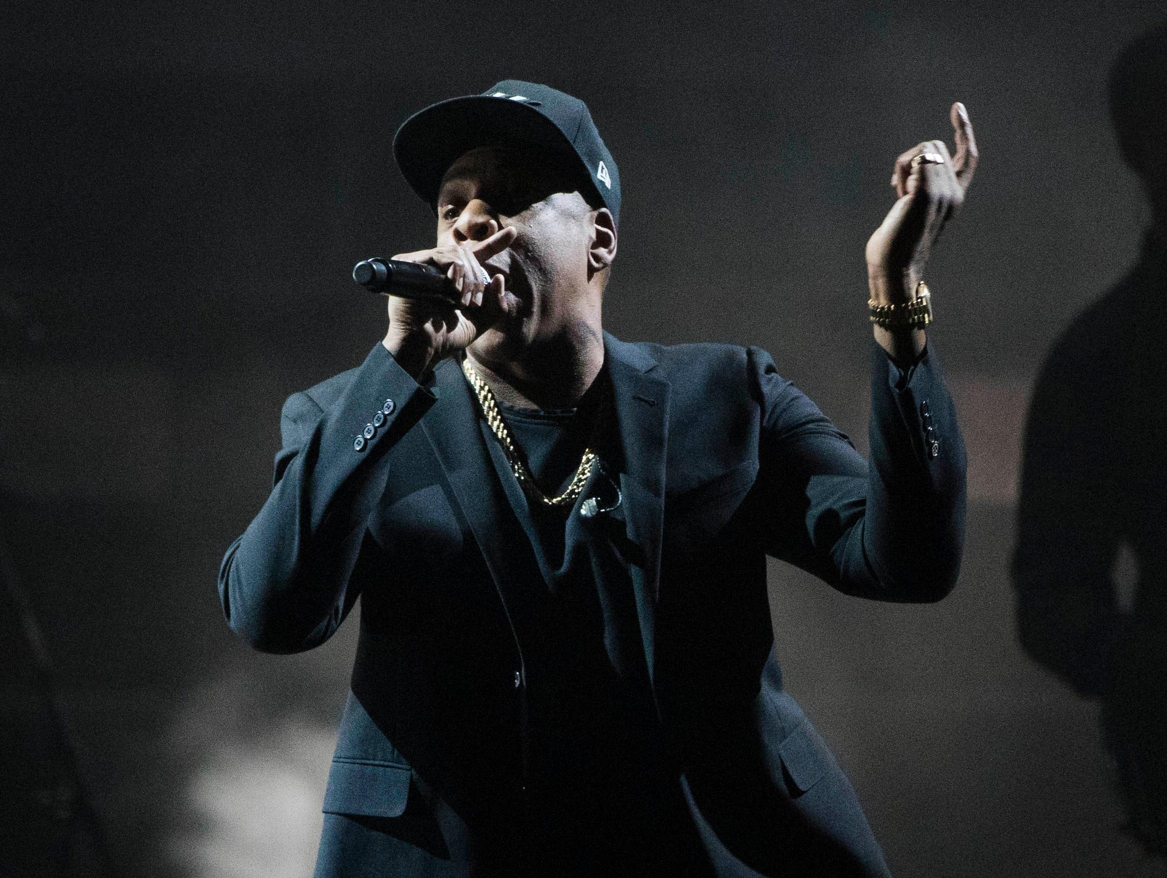 FILE- In this Nov. 4, 2016, file photo, Jay Z performs during a campaign rally for Democratic presidential candidate Hillary Clinton in Cleveland. Jay Z has signed a $200 million, 10-year deal with tour promoter Live Nation. (AP Photo/Matt Rourke, File)