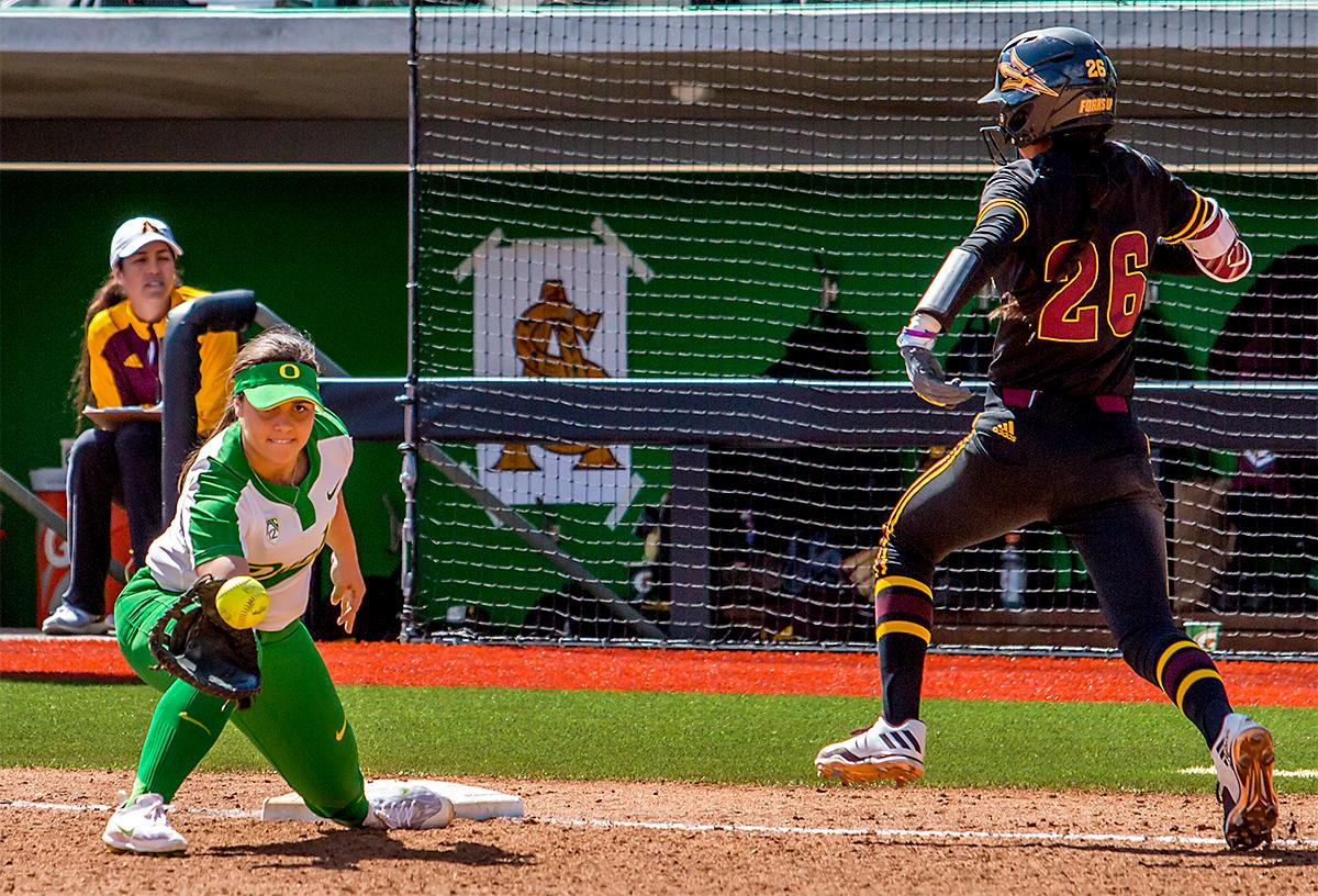 The Duck's Mia Camuso (#7) makes the catch to strike out the Sun Devils' Taylor Becerra (#26). The Oregon Ducks Softball team took their third win over the Arizona Sun Devils, 1-0, in the final game of the weekends series that saw the game go into an eighth inning before the Duck?s Mia Camuso (#7) scored a hit allowing teammate Haley Cruse (#26) to run into home plate for a point. The Ducks are now 33-0 this season and will next play a double header against Portland State on Tuesday, April 4 at Jane Sanders Stadium. Photo by August Frank, Oregon News Lab