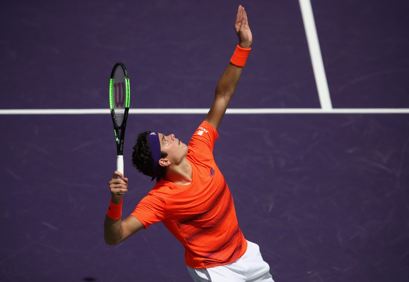 KEY BISCAYNE, FL - MARCH 24:  Milos Raonic of Canada in action against Viktor Troicki of Serbia at Crandon Park Tennis Center on March 24, 2017 in Key Biscayne, Florida.  (Photo by Julian Finney/Getty Images)