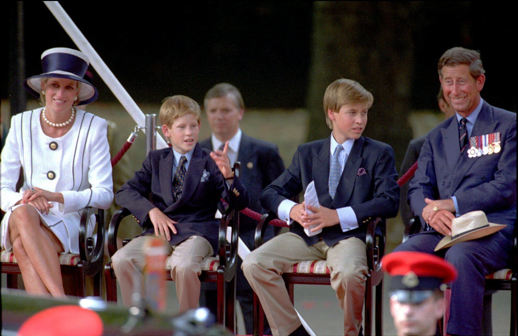 "FILE - In this Aug. 19, 1995 file photo, from left, Princess Diana, her sons Prince Harry and Prince William and Prince Charles, from left, watch a veteran's parade during the 50th anniversary of VJ Day commemorations in London. It has been 20 years since the death of Princess Diana in a car crash in Paris and the outpouring of grief that followed the death of the ""people's princess.""  (AP Photo/Alastair Grant, File)"