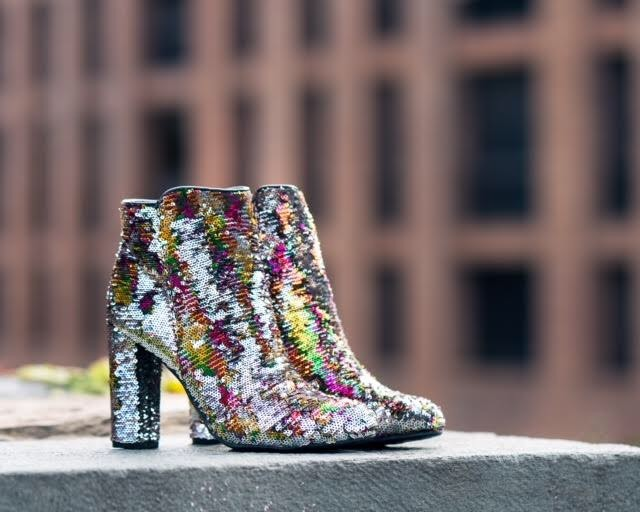 Take full advantage of the holiday and wear this multi-colored sequin skirt ($67.25) /bootie ($72.00) combo. I'd pair it with a plain black top and simple black blazer for an easy, chic ensemble. (Image: Courtesy Violet Boutique)