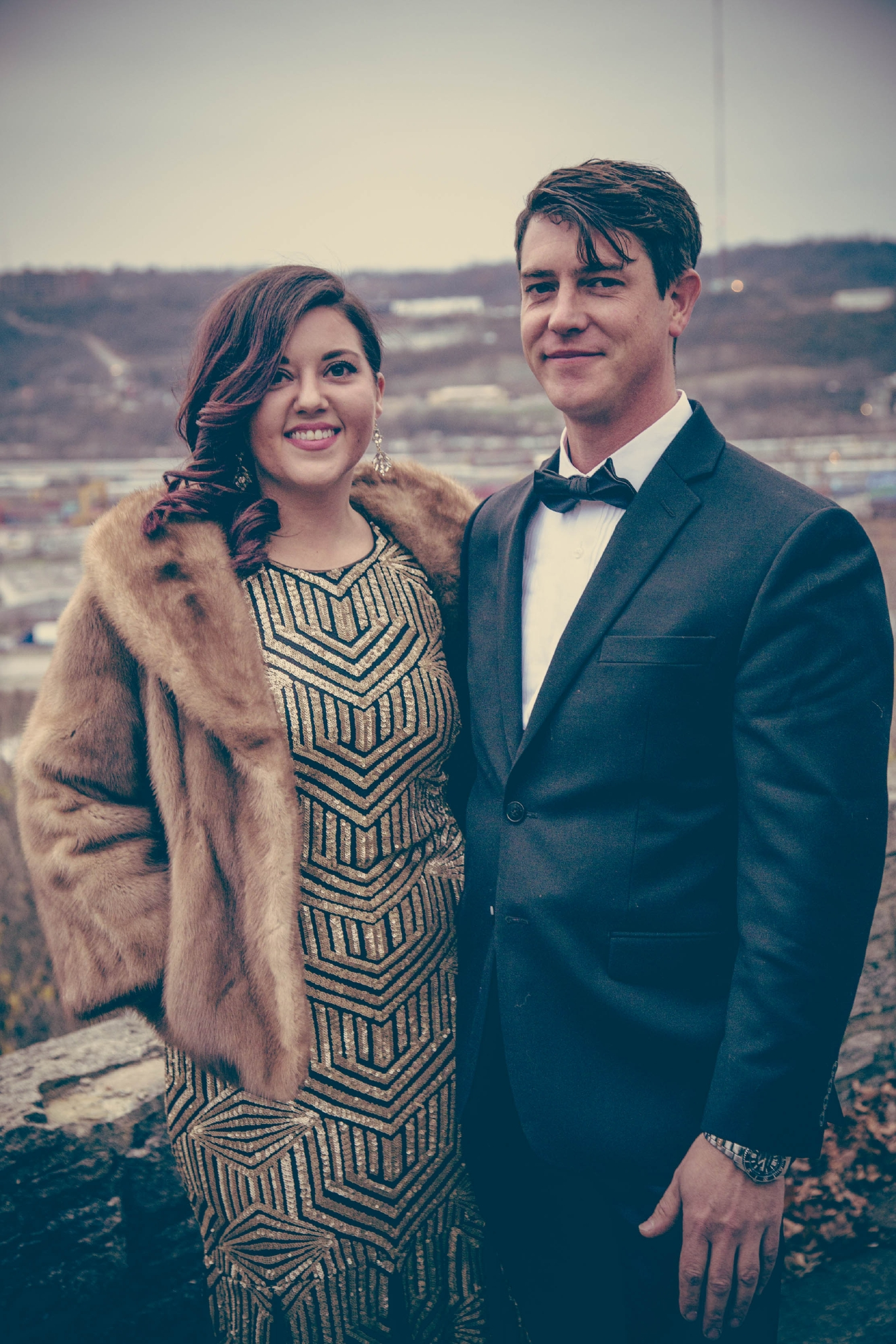 Tara Behrens in a Calvin Klein dress with a vintage Shillito's fur coat, and Chris Bogen in a Calvin Klein suit at Fairview Park. / Image: Catherine Viox // Published: 12.23.16
