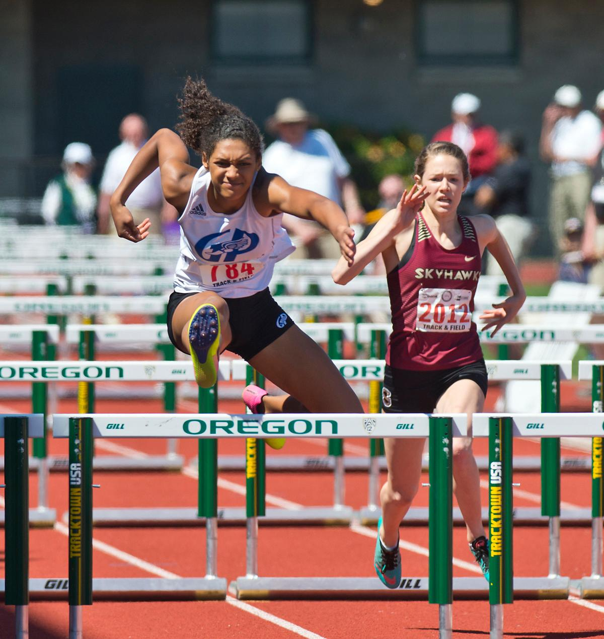 Deshae Wise from Grants Pass wins the 6A Girls 100 meter Hurdles with a time of 13.96 at the OSAA Championship at Hayward Field on Saturday. Photo by Dan Morrison, Oregon News Lab