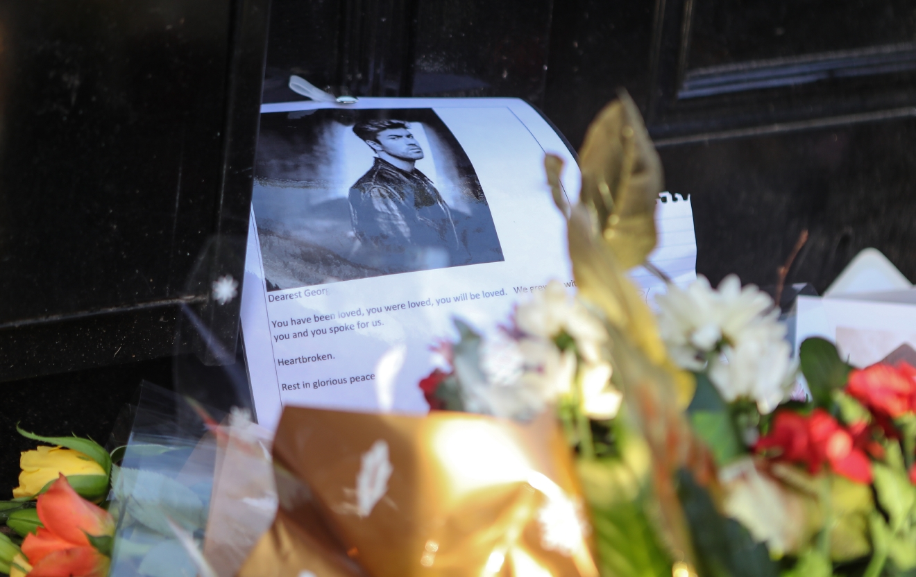 People leave candles and floral tributes outside the Highgate home of George Michael after his death on Christmas Day  Featuring: Atmosphere Where: London, United Kingdom When: 26 Dec 2016 Credit: WENN.com