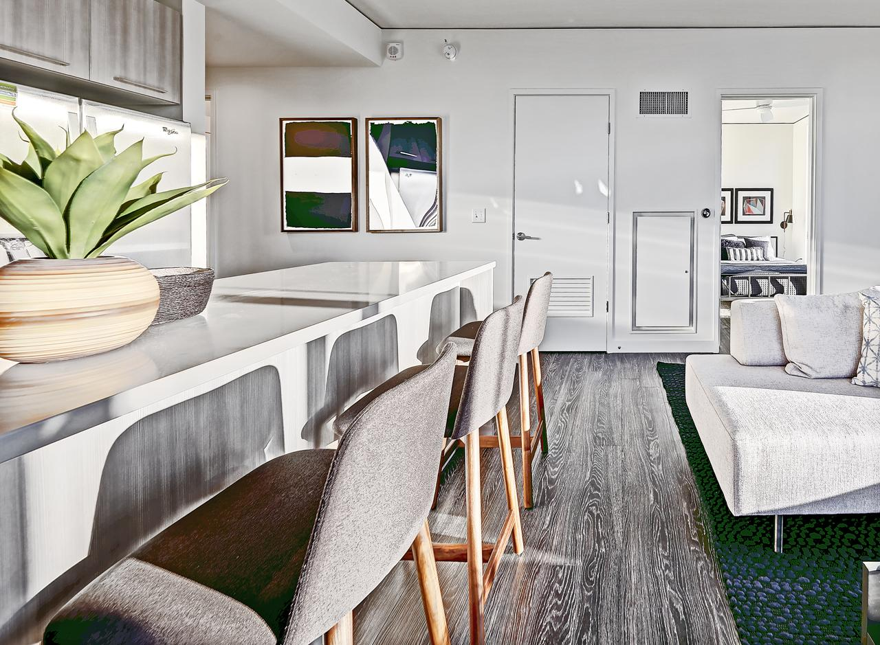 The kitchen and living area in a two bedroom apartment at AMLI Arc