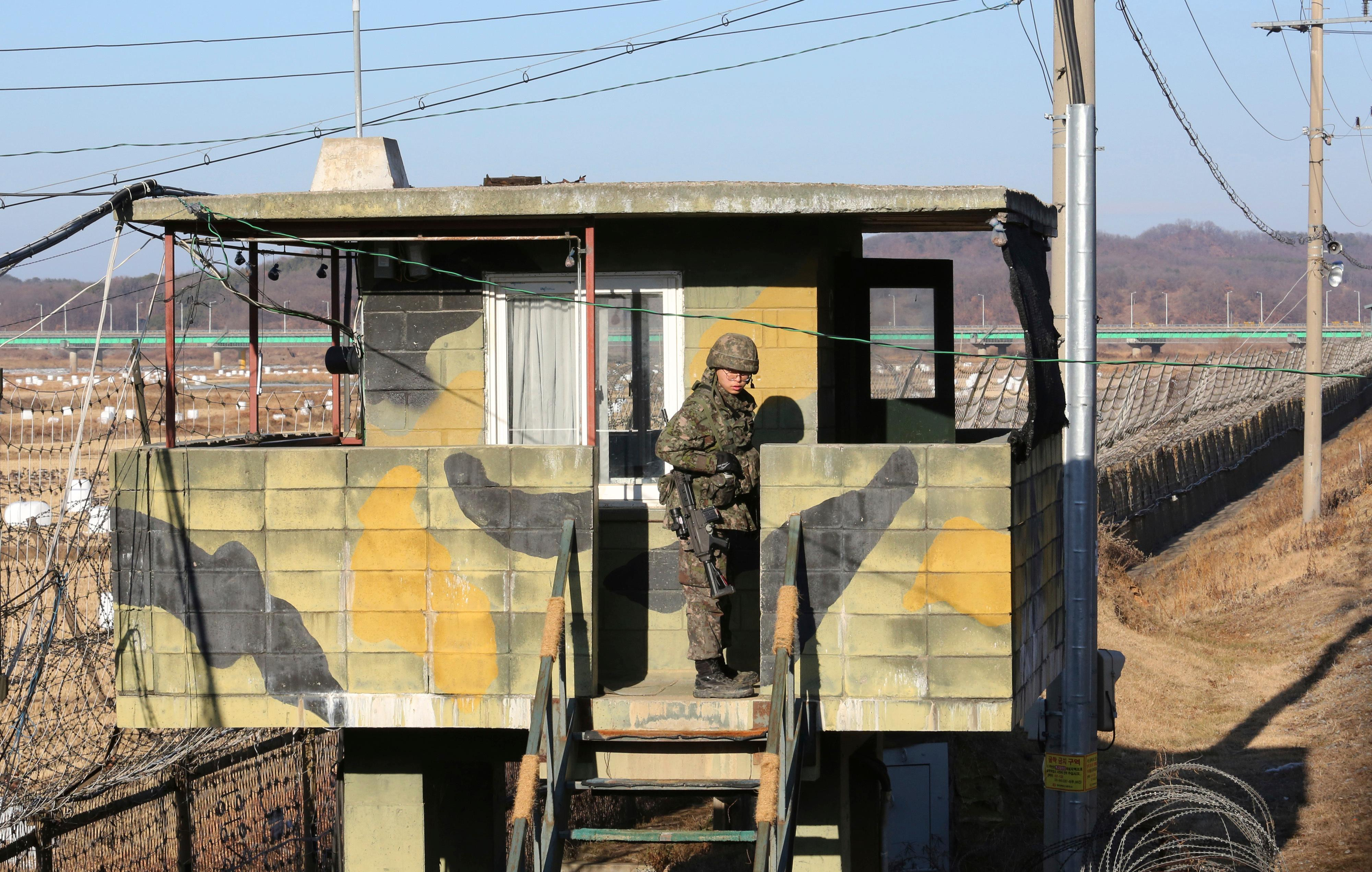 "A South Korean army soldier stands guard at a military guard post in Paju, South Korea, near the border with North Korea Monday, Dec. 25, 2017. North Korea on Sunday called the latest U.N. sanctions to target the country ""an act of war"" that violates its sovereignty, and said it is a ""pipe dream"" for the United States to think it will give up its nuclear weapons. (AP Photo/Ahn Young-joon)"