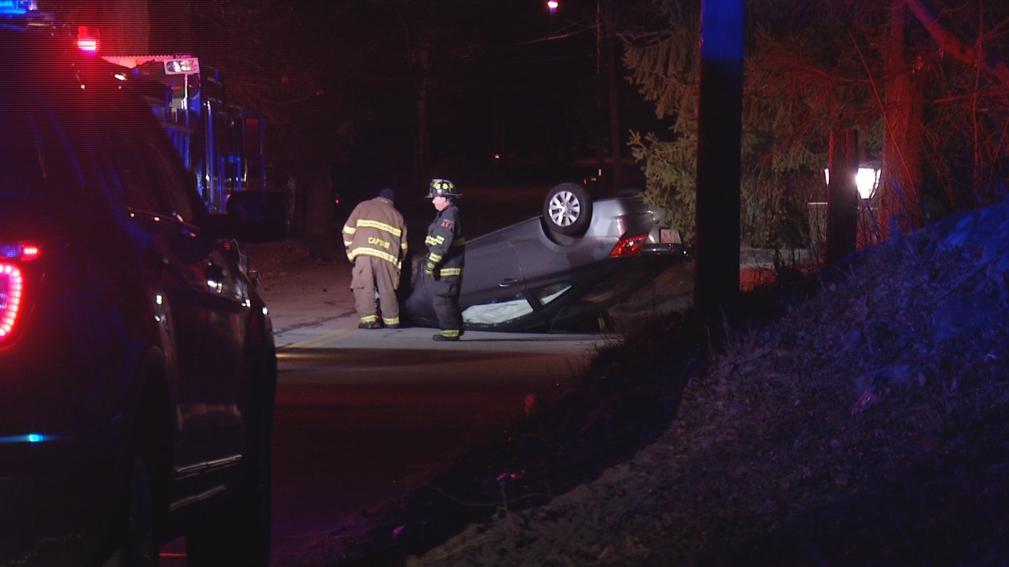 A car flipped onto its roof on Rocklawn Avenue in Attleboro, early Friday, April 6, 2018. (WJAR)