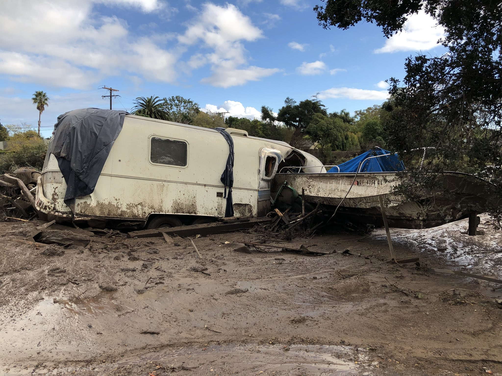 Damaged vehicles that were pushed by mudflow and onto the US 101 Freeway from nearby residential area in Montecito.(Photo & Caption: Mike Eliason, Santa Barbara County Fire Dept.)