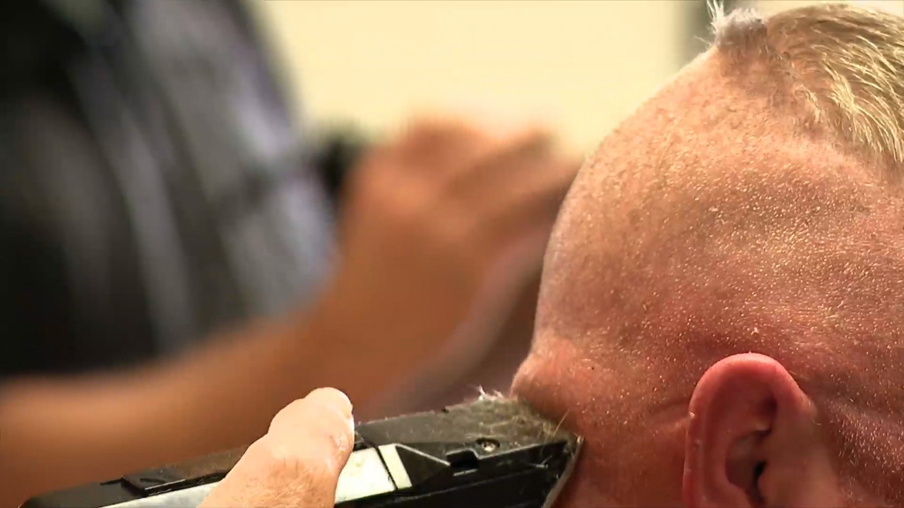 Many people rushed to local barbershops, which were set to close at 5 p.m. Wednesday because of the coronavirus outbreak. (Photo credit: WLOS staff)