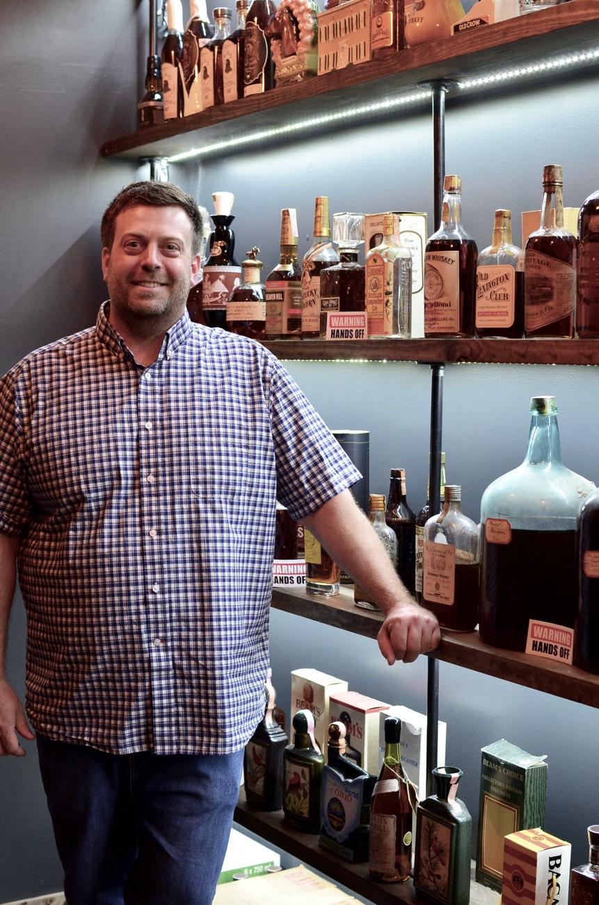 <p>Brad Bonds runs the Vintage Bourbon Library at Cork 'n Bottle. / Image: Leah Zipperstein, Cincinnati Refined // Published: 7.10.18</p>