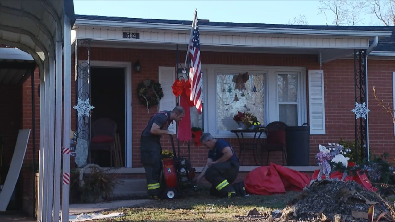 A Marion couple rushed home from work Thursday to find their house on fire ... their two dogs inside. (Photo credit: WLOS staff)