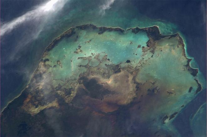 Sea, sand and clouds imitate a star forming nebula in the #Caribbean (Photo & Caption: Luca Parmitano, NASA)