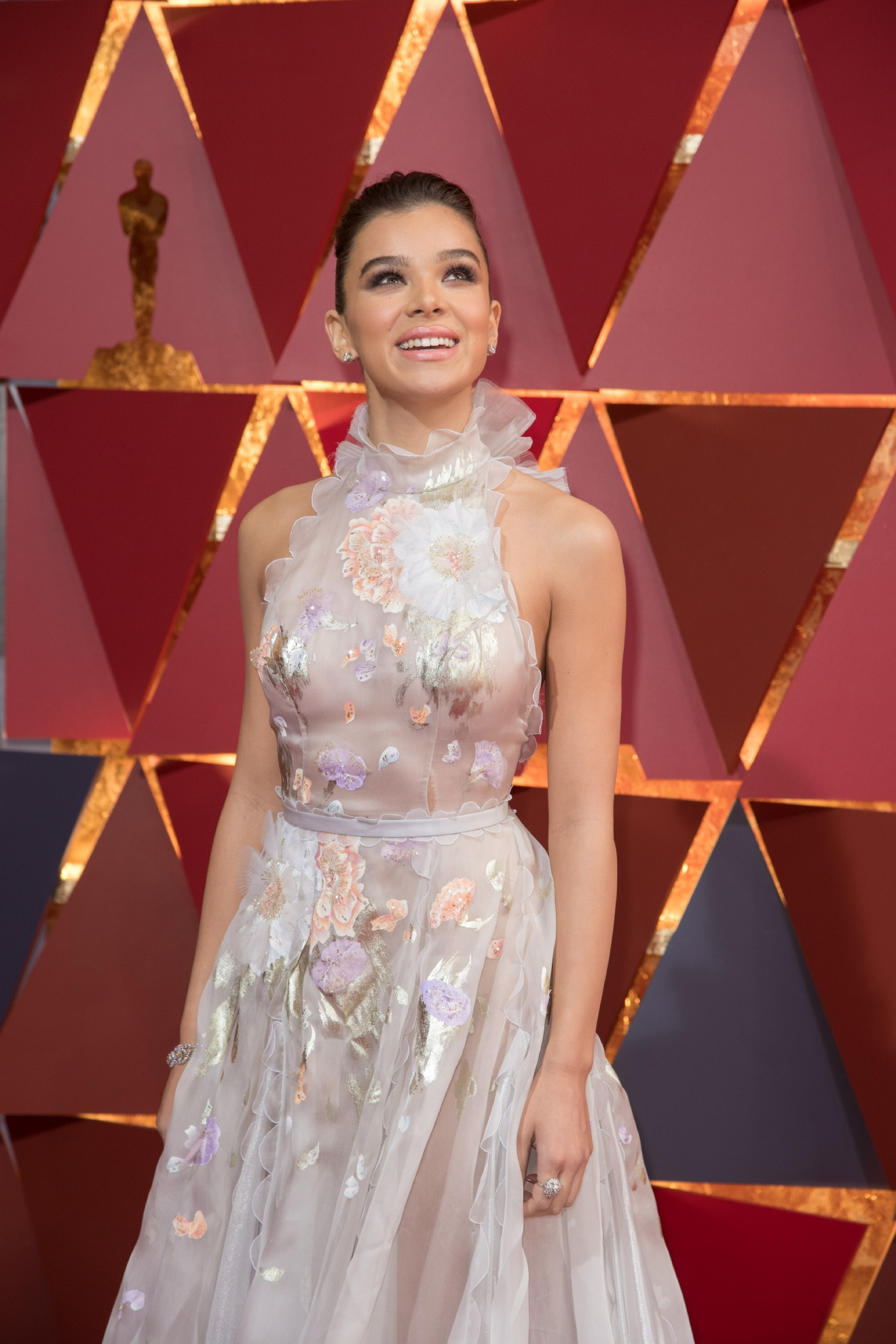 #41: Hailee Steinfeld. Make up your mind, Hailee! Ruffles, flowers, belts, collar....but your smile is gorgeous we'll give you that. (Image: AMPAS)