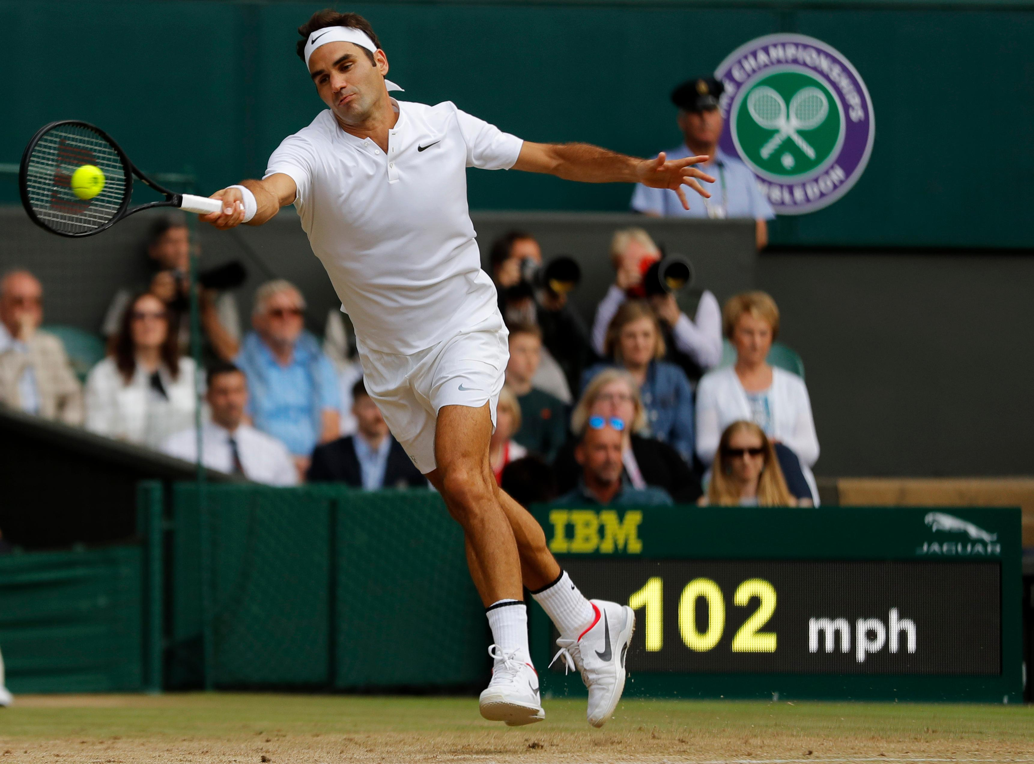 Switzerland's Roger Federer returns to Czech Republic's Tomas Berdych during their Men's Singles semifinal match on day eleven at the Wimbledon Tennis Championships in London, Friday, July 14, 2017. (AP Photo/Alastair Grant)