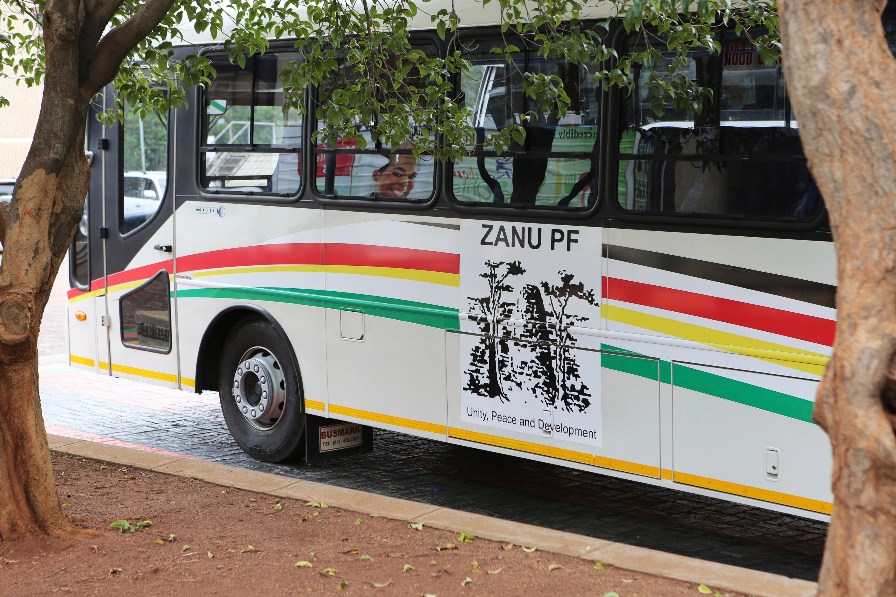 A bus belonging to the Zanu pf party is parked outside the party headquarters in Harare, Zimbabwe Sunday, Nov. 19, 2017. Clinging to his now virtually powerless post, longtime Zimbabwe President Robert Mugabe on Sunday was set to discuss his expected exit with the army commander who put him under house arrest, while the ruling party prepared to recall the world's oldest head of state as its leader. (AP Photo/Tsvangirayi Mukwazhi)