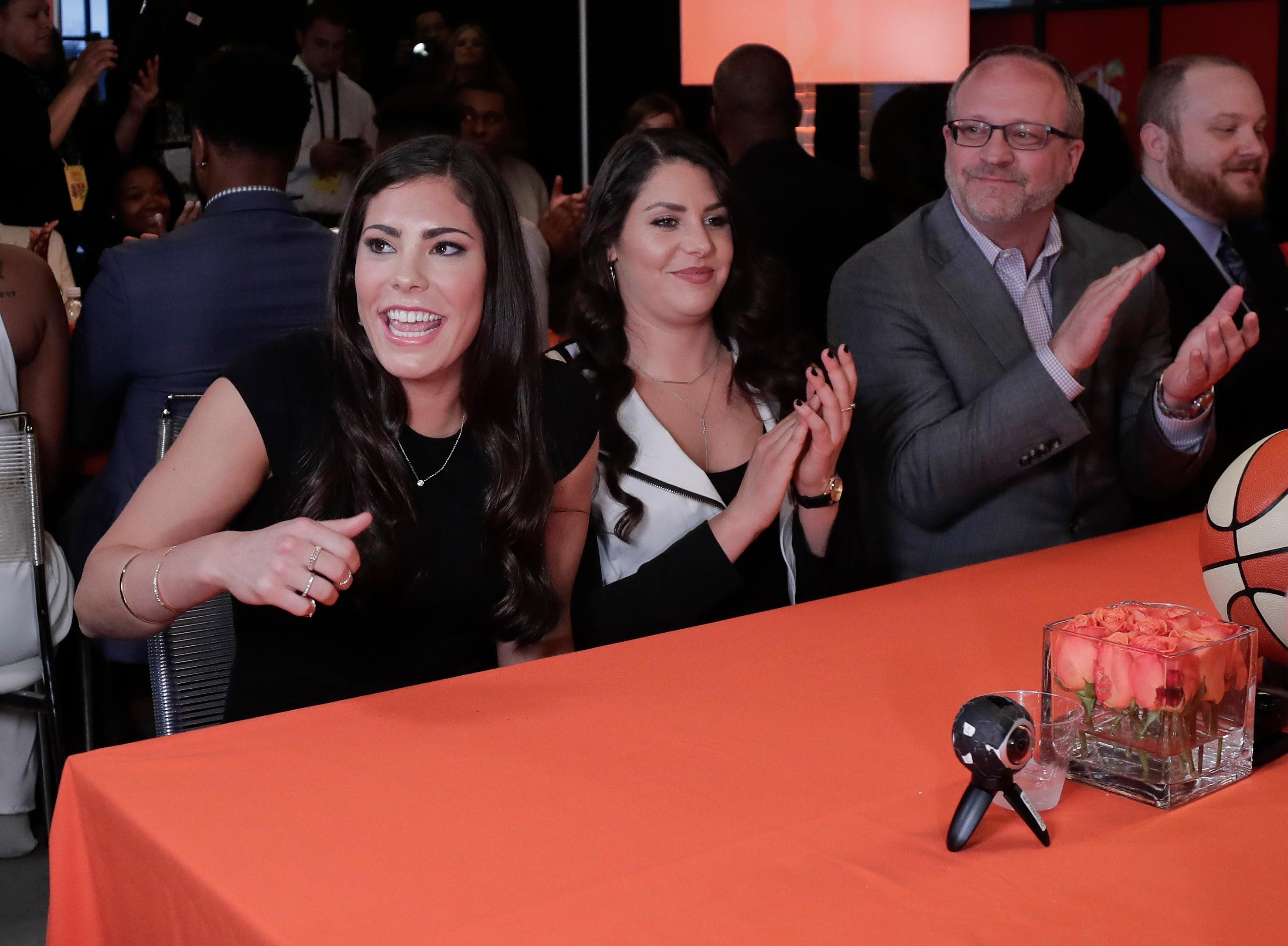 Kelsey Plum, left, reacts after being announced as the No. 1 pick in the WNBA basketball draft by the San Antonio Stars, Thursday, April 13, 2017, in New York. (AP Photo/Julie Jacobson)