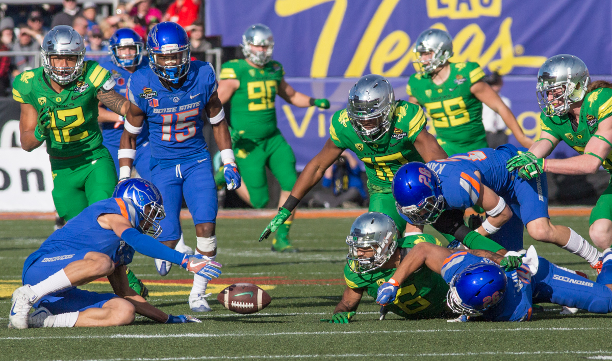 Players from both teams scramble to pick up an Oregon fumble. The Boise State Broncos defeated the Oregon Ducks 38 to 28 in the 2017 Las Vegas Bowl at Sam Boyd Stadium in Las Vegas, Nevada on Saturday December 17, 2017. The Las Vegas Bowl served as the first test for Oregon's new Head Coach Mario Cristobal following the loss of former Head Coach Willie Taggart to Florida State University earlier this month. Photo by Ben Lonergan, Oregon News Lab